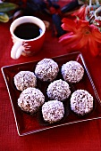 Chocolate truffles coated in grated coconut