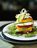 Tomato and avocado tower with mozzarella and crabmeat