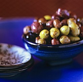 Mixed olives with herbs in a bowl