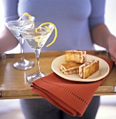 Ham and cheese on toast beside Martini glasses