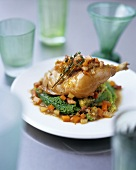 Chicken leg with hearty vegetables and thyme