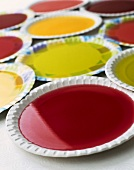 Coloured jellies on paper plates
