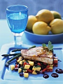 Fish steak on fruity vegetable salad