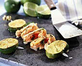 Barbecued lamb kebab with limes