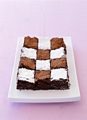 Dark sponge cake with chess board design