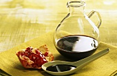 Unsweetened pomegranate syrup in a carafe