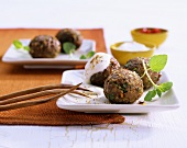 Meat and vegetables balls with dip
