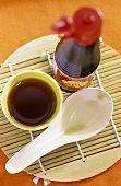 Soy sauce, in bottle and in small bowl
