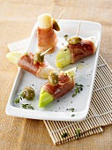 Pieces of leek wrapped in ham