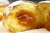 Broken doughnut with jam running out