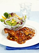 Chicken with chili sauce and salad
