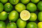Fresh mini-limes, one halved
