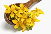 Wooden spoon with St. John's wort flowers