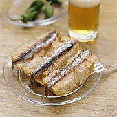 Anchovy fillets on slices of white bread