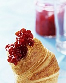 Papaya and raspberry jam on a croissant
