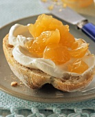 Passion fruit and orange jelly on a roll with fresh cheese