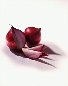Two red onions, one cut open