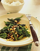 Spinach with raisins and slivered almonds