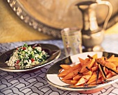 Middle Eastern carrots, couscous salad behind