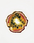 Slice of passion fruit, backlit