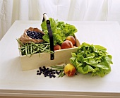 Fruit and vegetables in a wooden crate