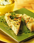 A piece of salmon and herb quiche on a plate