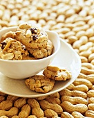 Peanut cookies in a bowl on peanuts