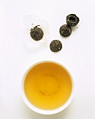 Pressed green tea (unpacked tea nests)