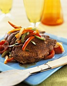 Marinated chicken breast fillets with peppers
