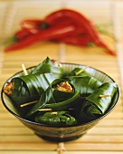 Marinated chicken pieces in banana leaves