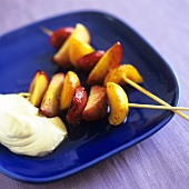 Grilled fruit kebabs with whipped cream