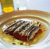 Sardines on peppers with olive oil