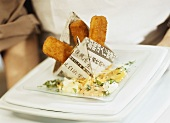 Fish fingers in a paper boat with dips