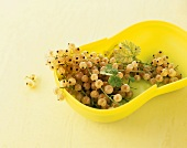 White currants in a yellow bowl