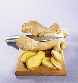 Fresh ginger root, partly sliced
