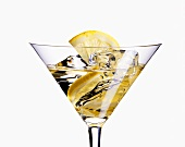 Martini with ice cubes and lemon
