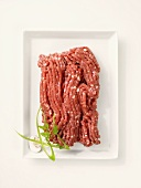 Fresh minced beef on a rectangular plate
