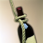 Red wine bottle with rope