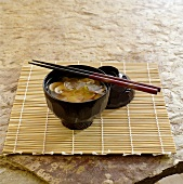 Miso soup in small black bowl