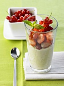 Crème dessert with strawberries and redcurrants