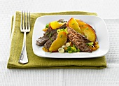 Beef fillet, sliced, with nectarine slices