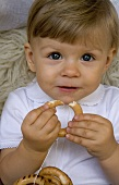 Small child with biscuit