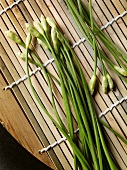 Chinese chives on bamboo background
