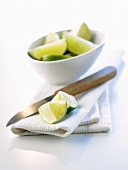 Kitchen cloth, kitchen knife and pieces of lime