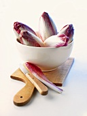 Red chicory in a bowl and on board