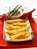 Chinese sweet potato sticks with sesame sauce