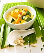 Vietnamese pumpkin soup with cashew kernels and courgettes