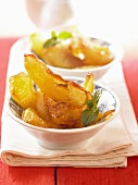 Caramelised apple wedges in batter