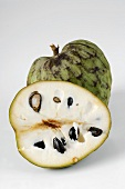 Half and whole cherimoya