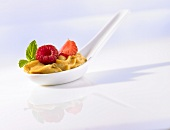 Coffee mousse with berries on a china spoon